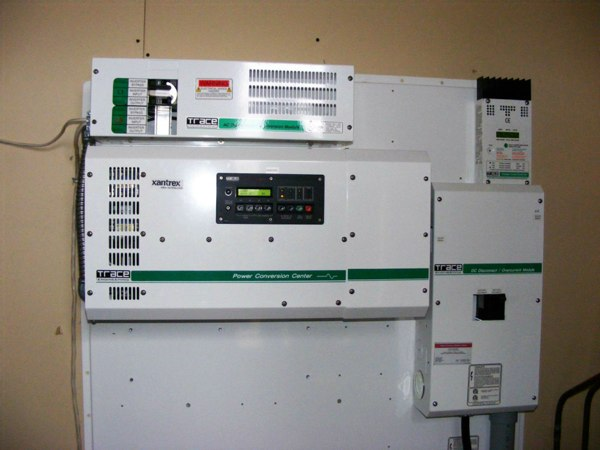 The brains of the operation, a Xantex controller, automatically regulates all output and charging, taking 24 volts DC and converting it to 120 volts AC for household use.